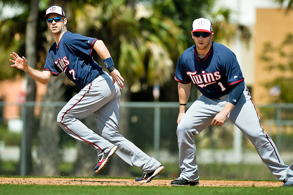 . Mauer, left, breaks for second base, with Alex Presley soon to follow, during base running drills. (Pioneer Press: Ben Garvin)