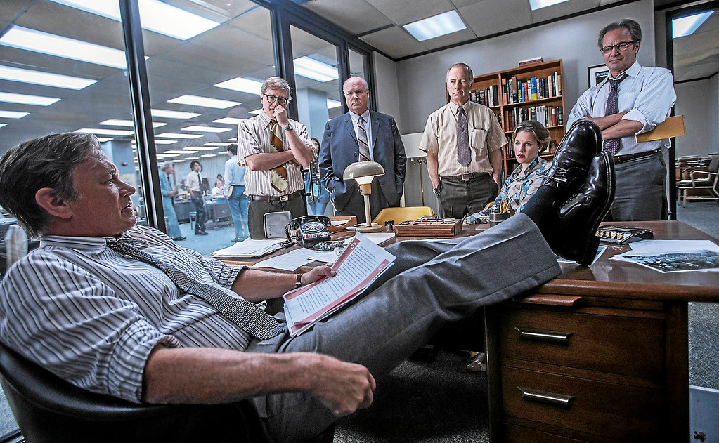 ". Tom Hanks, left, David Cross, John Rue, Bob Odenkirk, Jessie Mueller and Philip Casnoff portray Washington Post journalists in �The Post,\"" in theaters now. (Twentieth Century Fox)"