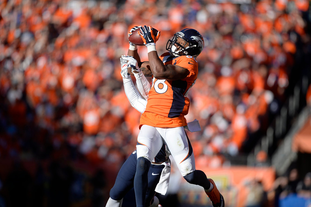 . Denver Broncos wide receiver Demaryius Thomas (88) makes a catch in the third quarter. The Denver Broncos take on the New England Patriots in the AFC Championship game at Sports Authority Field at Mile High in Denver on January 19, 2014. (Photo by AAron Ontiveroz/The Denver Post)