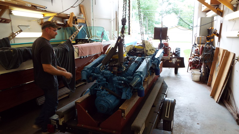 Unloading the restored engine from the storage trailer.
