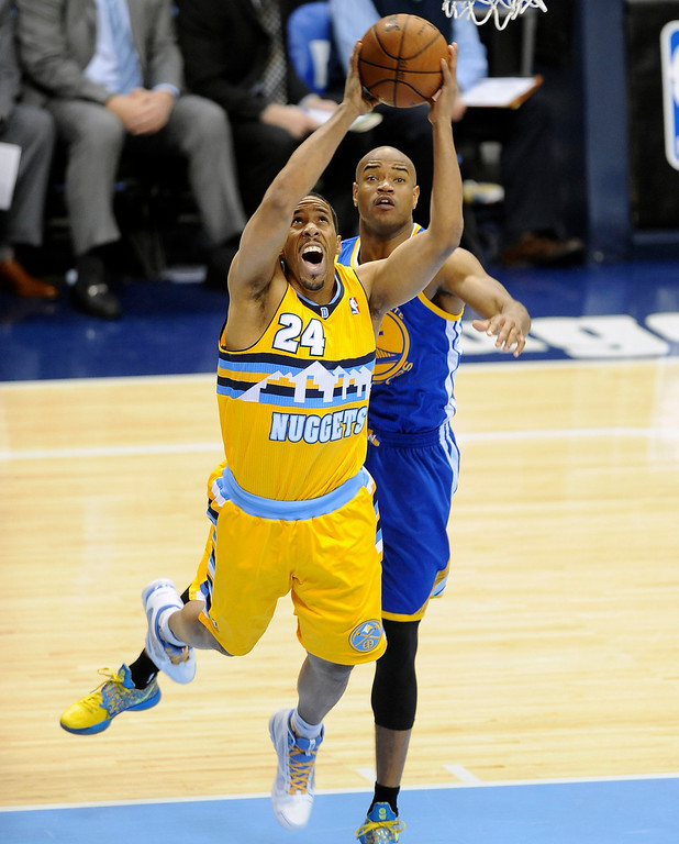 . DENVER, CO. - APRIL 20: Denver Nuggets guard Andre Miller (24) is fouled on a driving shot by Jarrett Jack (2) in the second quarter. The Denver Nuggets took on the Golden State Warriors in Game 1 of the Western Conference First Round Series at the Pepsi Center in Denver, Colo. on April 20, 2013. (Photo by Steve Nehf/The Denver Post)