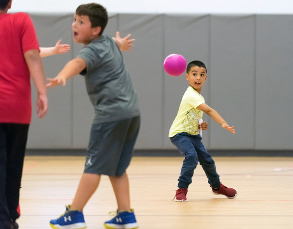 07/23/18 Wesley Bunnell | Staff Liam Messon, age 5, throws a ball towards Josh Brown, age 7, during a game of dodge ball at the Boys and Girls Club of Bristol on Monday afternoon.