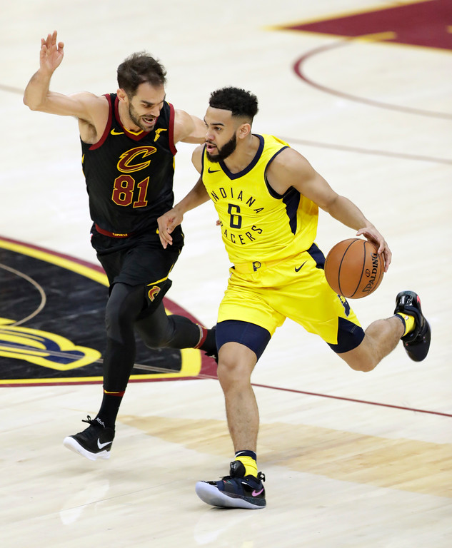. Indiana Pacers\' Cory Joseph (6) drives against Cleveland Cavaliers\' Jose Calderon (81), from Spain, in the second half of Game 5 of an NBA basketball first-round playoff series, Wednesday, April 25, 2018, in Cleveland. The Cavaliers won 98-95. (AP Photo/Tony Dejak)