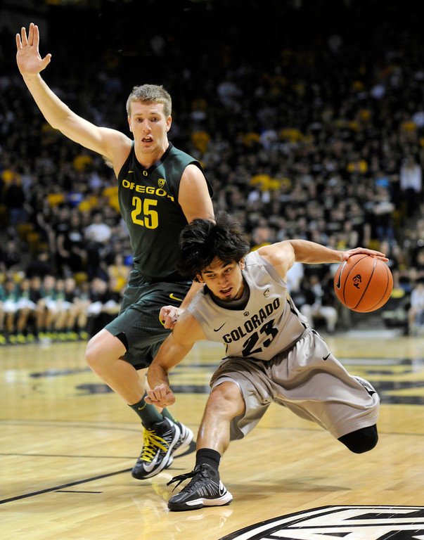. BOULDER, CO. - MARCH 7: Colorado guard Sabatino Chen (23) raced Oregon forward E.J. Singler (25) downcourt in the second half. The University of Colorado men\'s basketball team defeated Oregon 76-53 Thursday night, March 7, 2013 at the CU Events Center in Boulder. (Photo By Karl Gehring/The Denver Post)