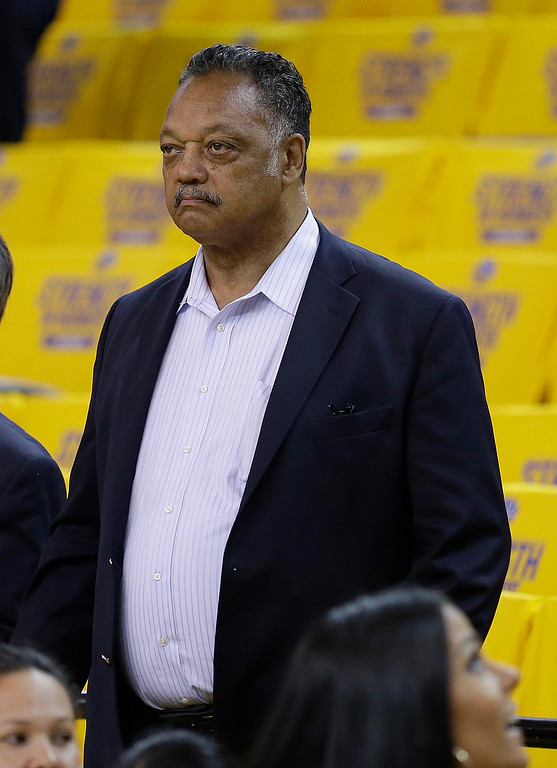 . Rev. Jesse Jackson watches as players warm up before Game 1 of basketball\'s NBA Finals between the Golden State Warriors and the Cleveland Cavaliers in Oakland, Calif., Thursday, June 4, 2015. (AP Photo/Ben Margot)