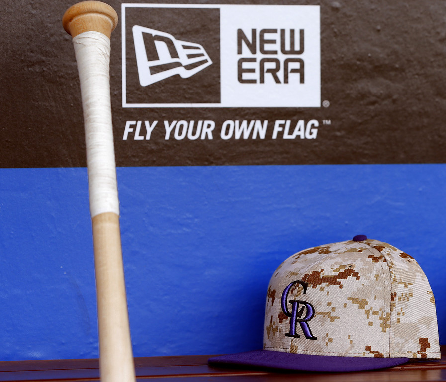 . PHILADELPHIA, PA - MAY 26: A Colorado Rockies camouflaged caps in honor of Memorial Day sits on the bench before the start of their game against the Philadelphia Phillies at Citizens Bank Park on May 26, 2014 in Philadelphia, Pennsylvania. (Photo by Rich Schultz/Getty Images)