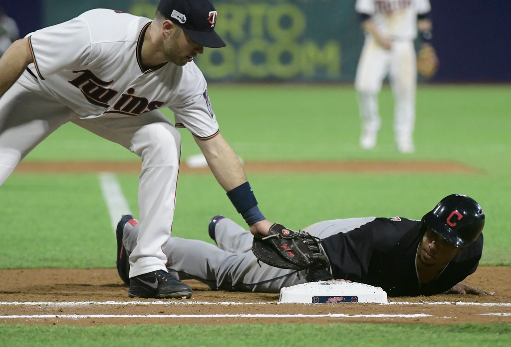 . Cleveland Indian\'s outfielder Michael Brantley lands safely to first during the eighth inning of the final match at a two-game Mayor League Series against the Minnesota Twins at Hiram Bithorn Stadium in San Juan, Puerto Rico, Wednesday, April 18, 2018. (AP Photo/Carlos Giusti)