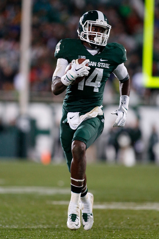 . Michigan State\'s Tony Lippett runs for a 32-yard touchdown against Nebraska during the third quarter of an NCAA college football game, Saturday, Oct. 4, 2014, in East Lansing, Mich. Michigan State won 27-22. (AP Photo/Al Goldis)