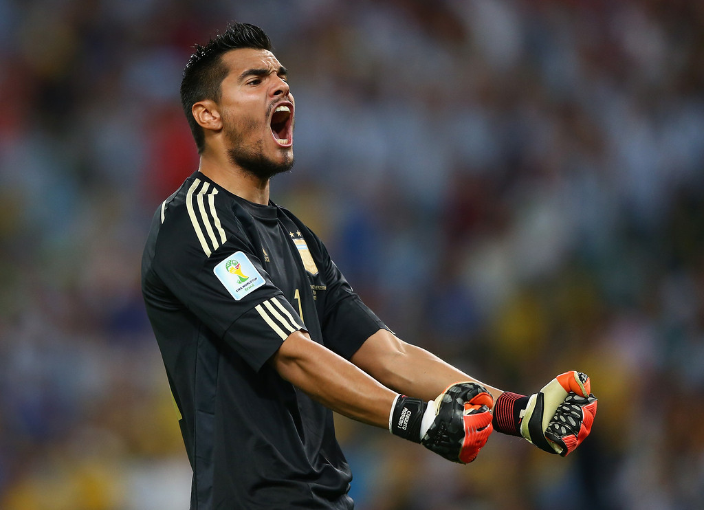 . Sergio Romero of Argentina celebrates after defeating Bosnia and Herzegovina 2-1 during the 2014 FIFA World Cup Brazil Group F match between Argentina and Bosnia-Herzegovina at Maracana on June 15, 2014 in Rio de Janeiro, Brazil.  (Photo by Jamie Squire/Getty Images)