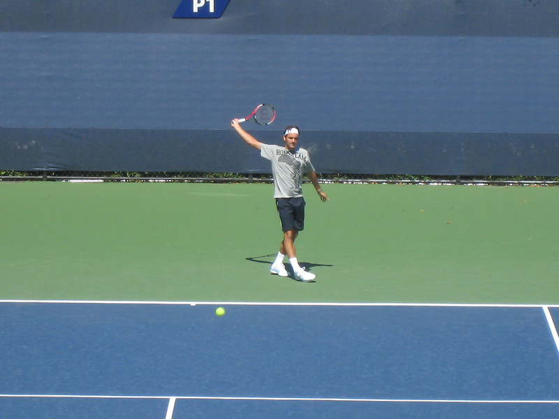 Roger practicing backhand
