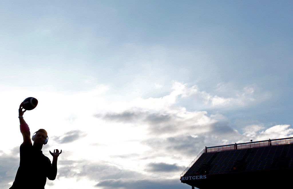 . Rutgers quarterback Gary Nova (10) is silhouetted as he warms up for an NCAA college football game against Michigan. Saturday, Oct. 4, 2014, in Piscataway, N.J. (AP Photo/Rich Schultz)