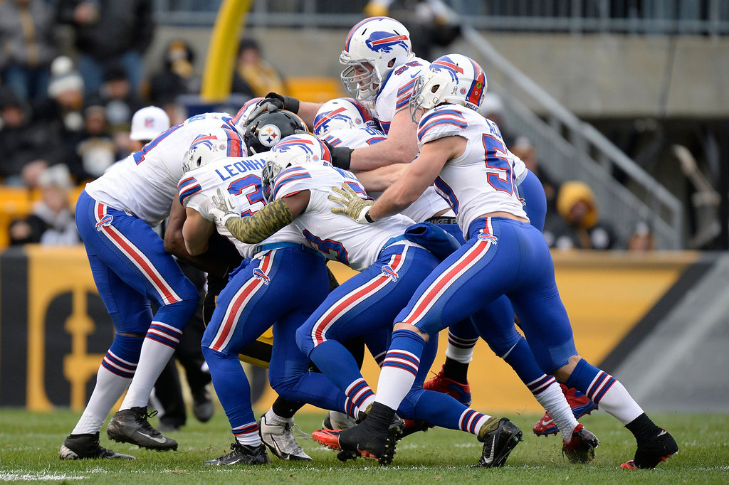 . Pittsburgh Steelers\' Le\'Veon Bell is gang-tackled by the Buffalo Bills defense during the first half of an NFL football game on Sunday, Nov. 10, 2013, in Pittsburgh. (AP Photo/Don Wright)