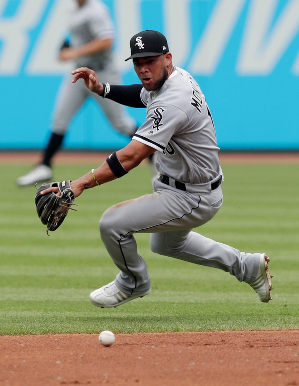 . Chicago White Sox\'s Yoan Moncada fields a ball hit by Cleveland Indians\' Greg Allen in the first inning of a baseball game, Wednesday, May 30, 2018, in Cleveland. Allen was safe at first base. (AP Photo/Tony Dejak)