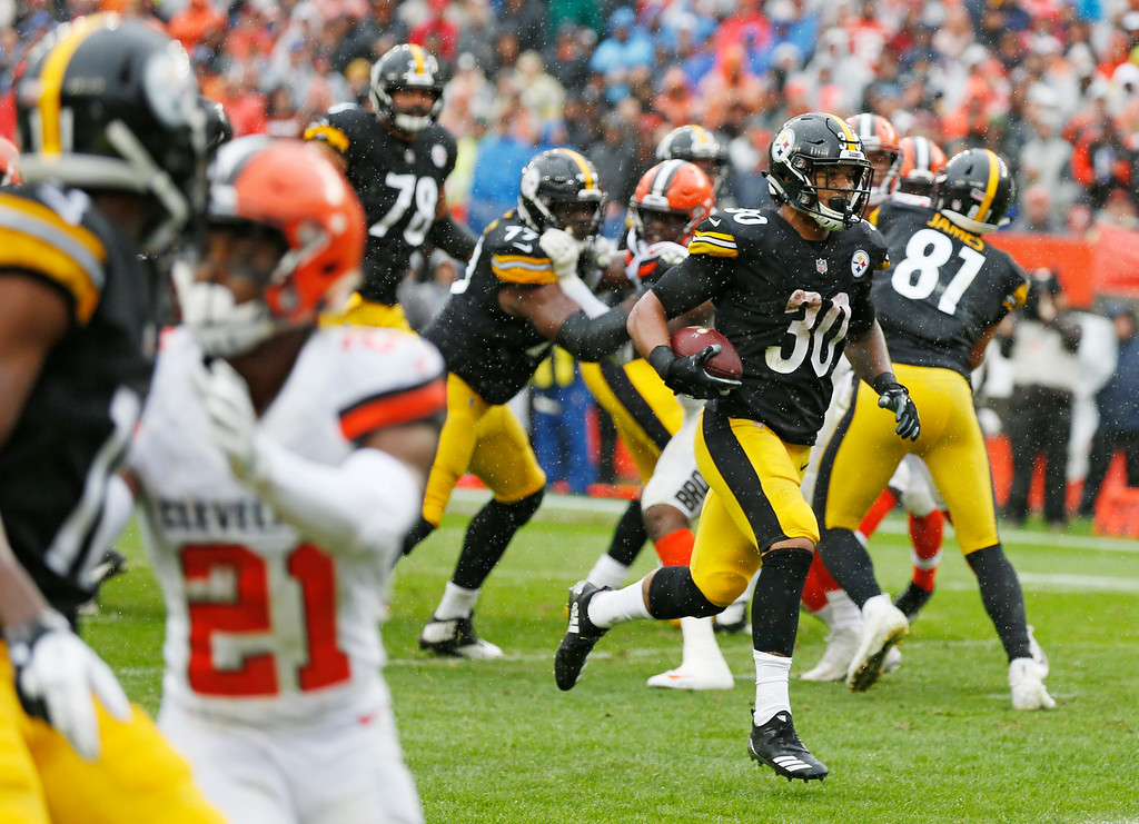 . Pittsburgh Steelers running back James Conner (30) rushes for a 4-yard touchdown during the first half of an NFL football game against the Cleveland Browns, Sunday, Sept. 9, 2018, in Cleveland. (AP Photo/Ron Schwane)