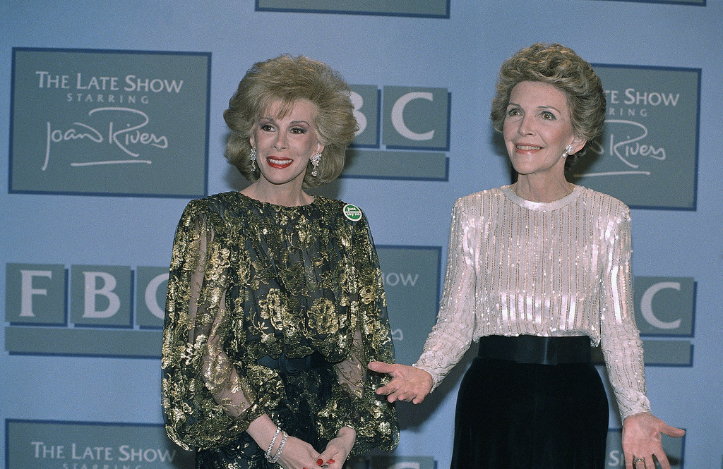 ". Late night talk show hostess Joan Rivers (left) poses with First Lady Nancy Reagan prior to taping of ""The Late Show Starring Joan Rivers\"" in Los Angeles at night on Thursday, Oct. 30, 1986. (AP Photo/Reed Saxon)"