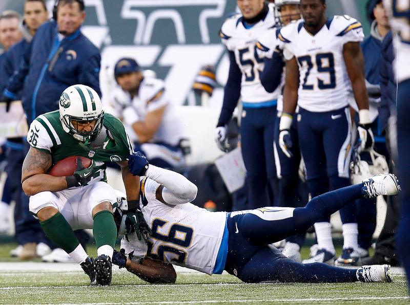 . Donald Butler #56 of the San Diego Chargers takes down Lex Hilliard #36 of the New York Jets at MetLife Stadium on December 23, 2012 in East Rutherford, New Jersey. (Photo by Jeff Zelevansky /Getty Images)