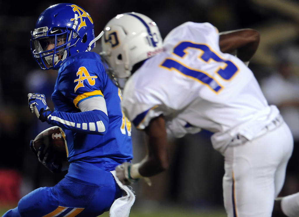 . Bishop Amat\'s Trevon Sidney (18) intercepts a Charter Oak pass ahead of Dareon Nash (13) in the first half of a prep football game at Bishop Amat High School in La Puente, Calif. on Friday, Sept. 20, 2013.    (Photo by Keith Birmingham/Pasadena Star-News)