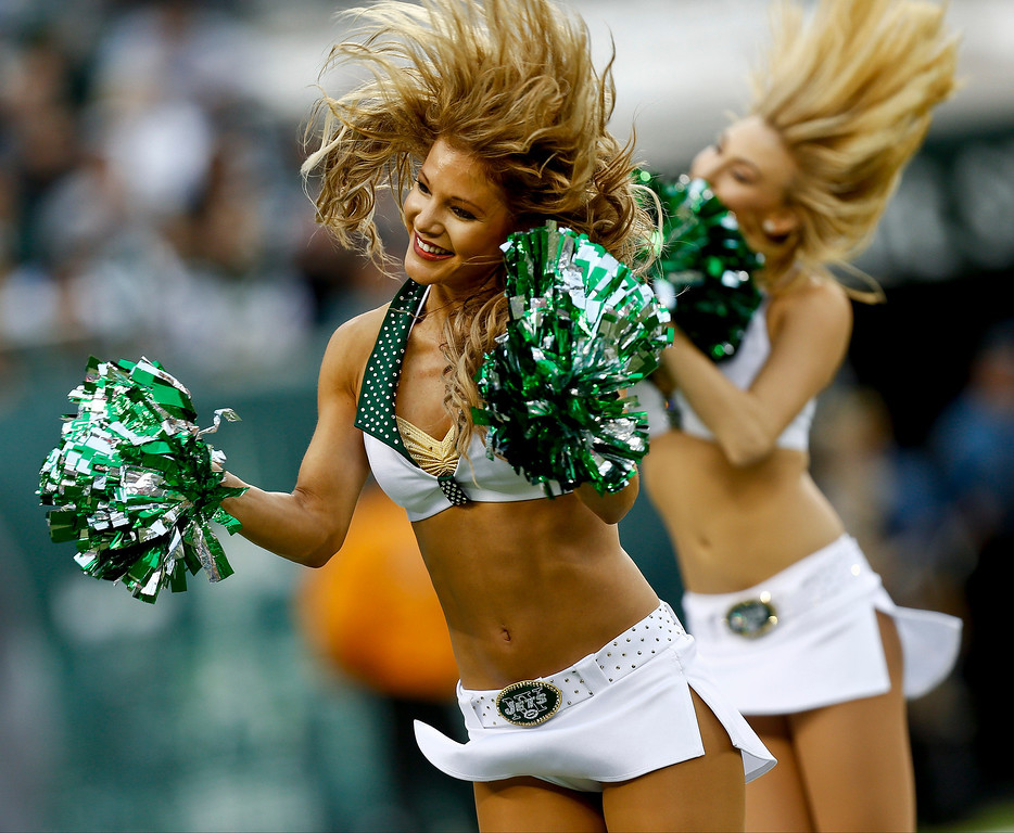 . EAST RUTHERFORD, NJ - DECEMBER 22:   The Jets Flight Crew cheerleaders perform during their game against the Cleveland Browns at MetLife Stadium on December 22, 2013 in East Rutherford, New Jersey.  (Photo by Jeff Zelevansky/Getty Images)