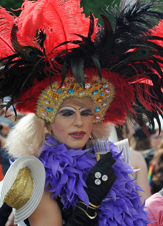 . A drag queen  attends the annual Gay, Bisexual and Transgender equality march in Warsaw, Poland, Saturday, June 15, 2013. The parade participants demanded  equal rights for gay partnerships   in this conservative, mostly Catholic country  where they still face significant prejudice. (AP Photo/Alik Keplicz)