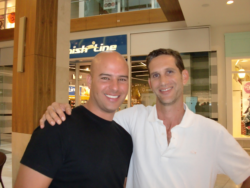 . Friends Udi Shabat of Woodland Hills and Ben Berkman of Woodland Hills pose outside the Verizon Wireless store at Westfield Topanga while waiting to get their new iPhones on Sept. 20, 2013, the debut day for the 5c and 5s models. (Photo by Steven Rosenberg/Los Angeles Daily News)