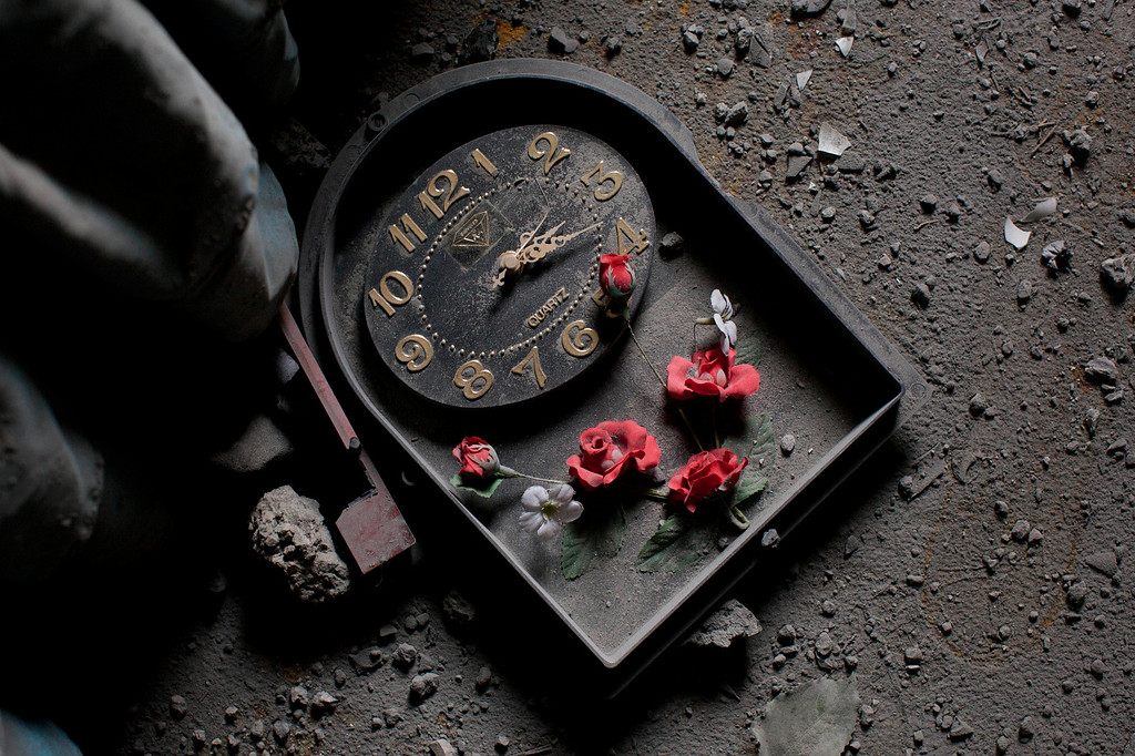 . In this Nov. 17, 2012 photo, a broken wall-clock lays on the floor of a house that was damaged after an Israeli airstrike at Hamas Prime Minister Ismail Haniyeh\'s office in Gaza City. This photo was one in a series of images by Associated Press photographer Bernat Armangue that won the first place prize in the World Press Photo 2013 photo contest for the Spot News series category.  (AP Photo/Bernat Armangue, File)