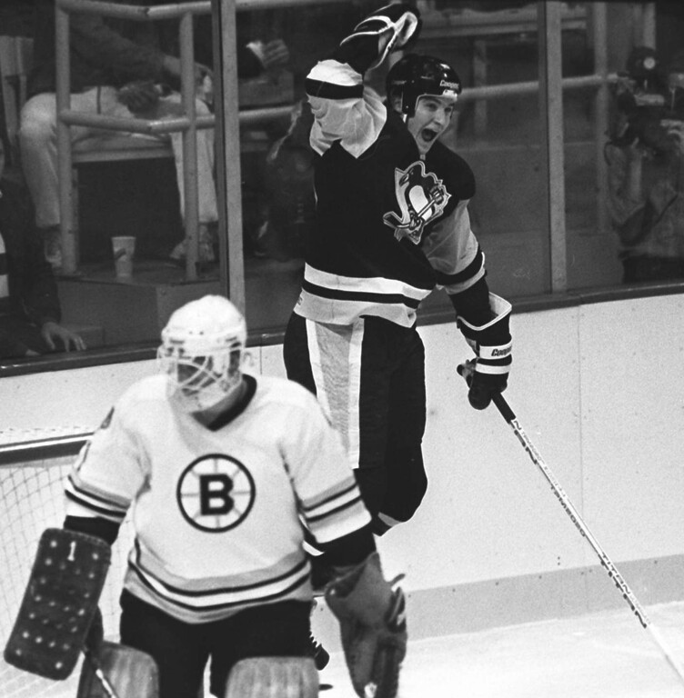 . ** FILE ** Pittsburgh Penguins\' Mario Lemieux reacts after scoring his first NHL hockey goal against Boston Bruins goalie Pete Peters in Boston, Oct. 12, 1984. Penguins star and owner Mario Lemieux, one of hockey\'s greatest players, is retiring for the second time, a team official said Tuesday, Jan. 24, 2006. (AP Photo/Paul Benoit, File)