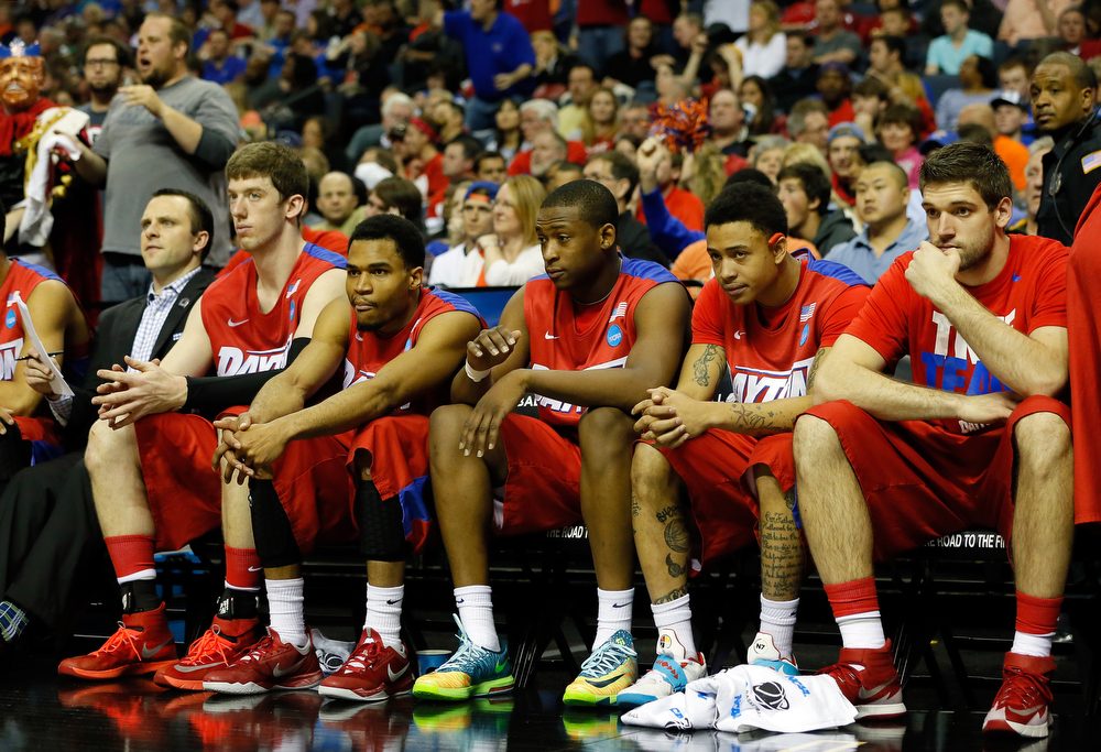 . The Dayton Flyers bench looks on in the second half against the Florida Gators during the south regional final of the 2014 NCAA Men\'s Basketball Tournament at the FedExForum on March 29, 2014 in Memphis, Tennessee.  (Photo by Kevin C. Cox/Getty Images)