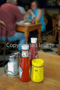 """LONDON, ENGLAND  -  Typical Table in """"Studio 6"""" Restaurant, with Various Condiments."""