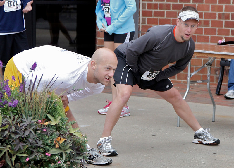 Runners stretch before the race begins.
