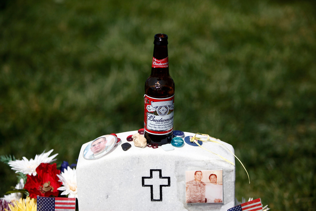 . A beer and other items left on the gravestone of Army Cpl. Joseph Hernandez, who died in Afghanistan on Jan. 9, 2009, in section 60 of Arlington National Cemetery on Memorial Day in Arlington, Va., May 28, 2012. (Luke Sharrett/The New York Times)