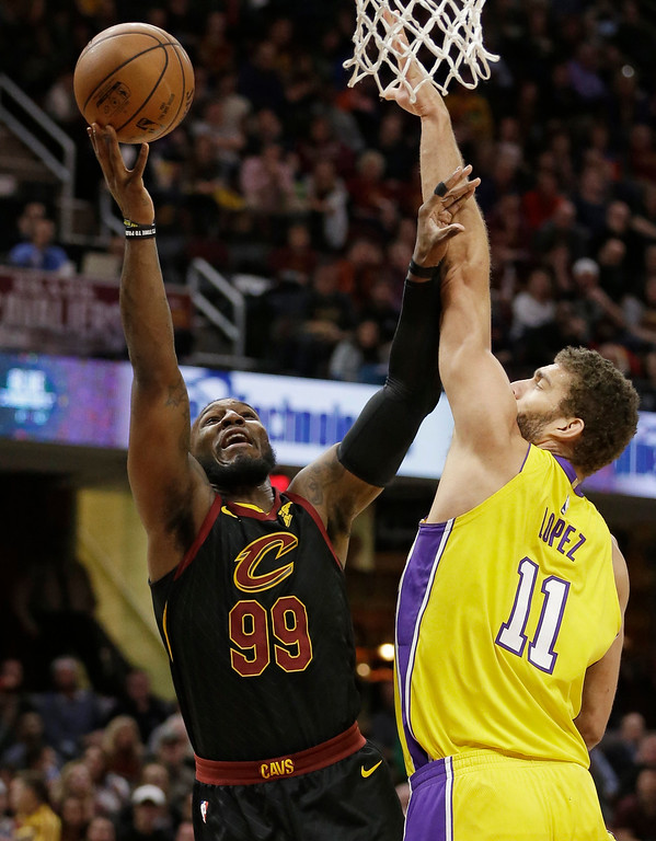 . Cleveland Cavaliers\' Jae Crowder (99) shoots against Los Angeles Lakers\' Brook Lopez (11) in the first half of an NBA basketball game, Thursday, Dec. 14, 2017, in Cleveland. (AP Photo/Tony Dejak)