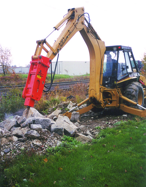 NPK E205 hydraulic hammer on Cat backhoe (1).jpg