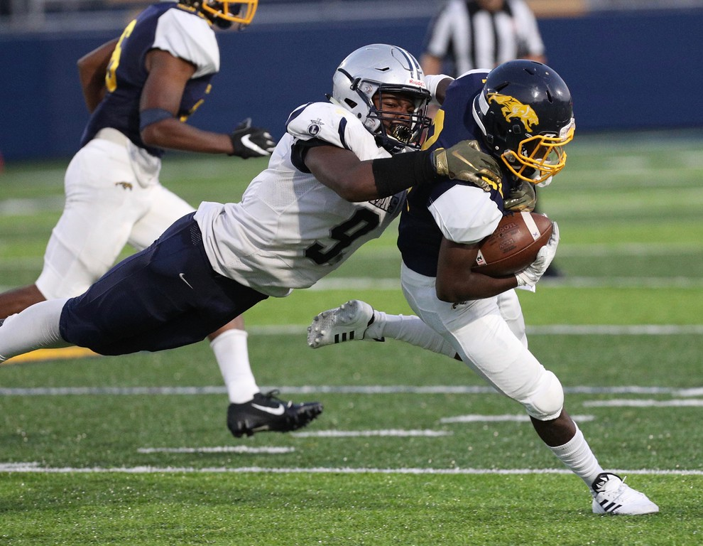 . Tim Phillis - The News-Herald Action from Euclid\'s game against Lorain Aug. 31.