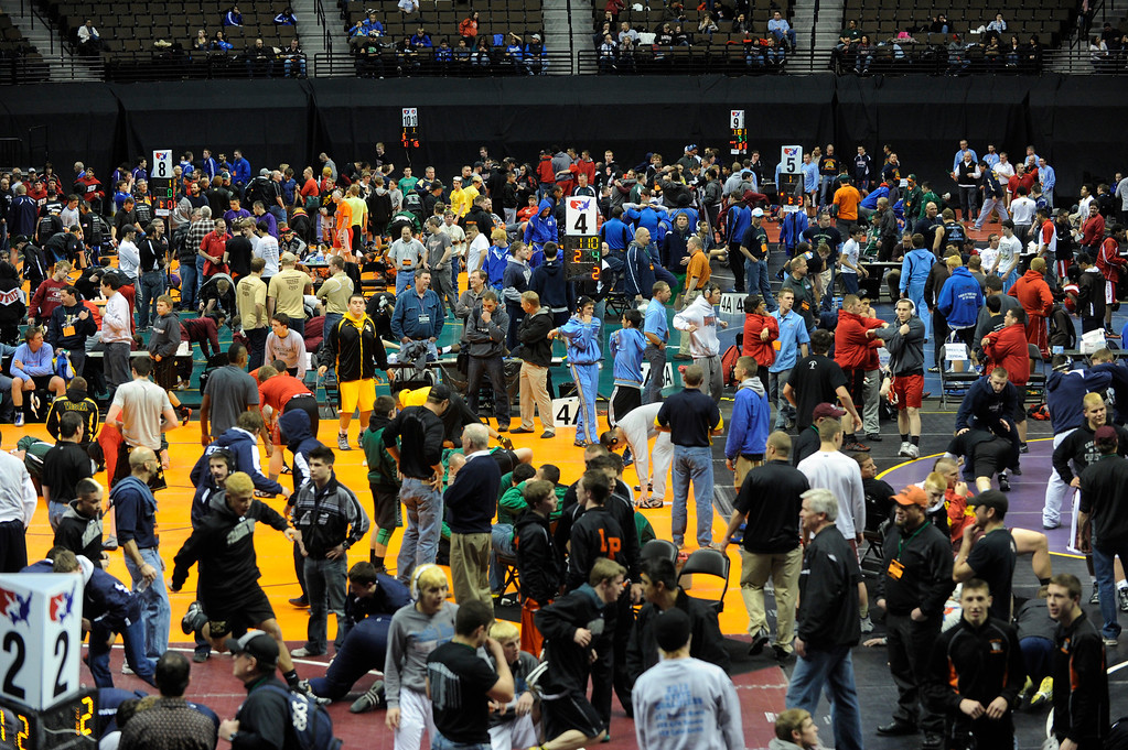 . DENVER, CO. - FEBRUARY 21: Wrestlers warmed up on the mats prior to the 4A and 5A competition Thursday night. The CHSAA State Wrestling Tournament kicked off Thursday, February 21, 2013 at the Pepsi Center in Denver.    (Photo By Karl Gehring/The Denver Post)
