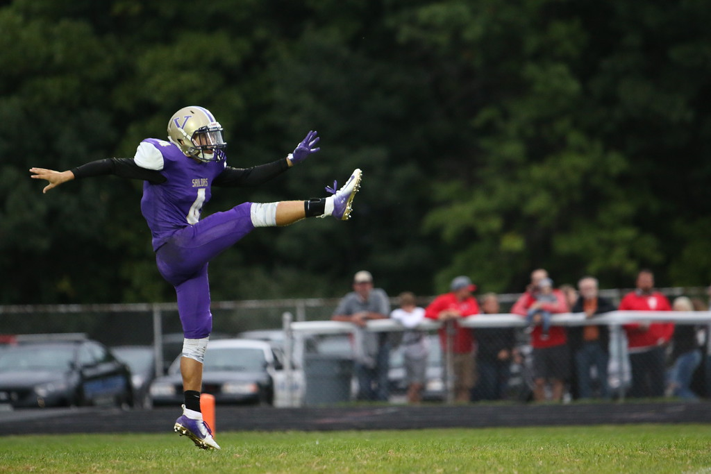 . Kyle Sooy - The Morning Journal<br> Vermilion\'s Jonah Pfeil punts the ball to Firelands on Sept. 7.