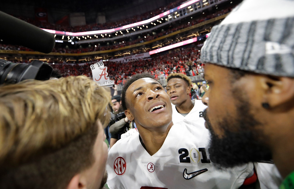 . Alabama\'s DeVonta Smith celebrates after overtime of the NCAA college football playoff championship game against Georgia Monday, Jan. 8, 2018, in Atlanta. Alabama won 26-23. (AP Photo/David J. Phillip)
