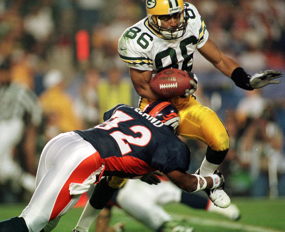 . Caption: Denver Broncos Tony Veland makes a tackle on Green Bay  Packers Antonio Freeman during Super Bowl XXXII in San Diego CA.  The Denver Broncos defeated the Green Bay Packers 31-24.  (John Leyba/The Denver Post)