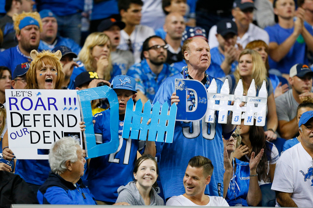. Detroit Lions fans cheer during the third quarter of an NFL football game against the New York Giants in Detroit, Monday, Sept. 8, 2014. (AP Photo/Rick Osentoski)