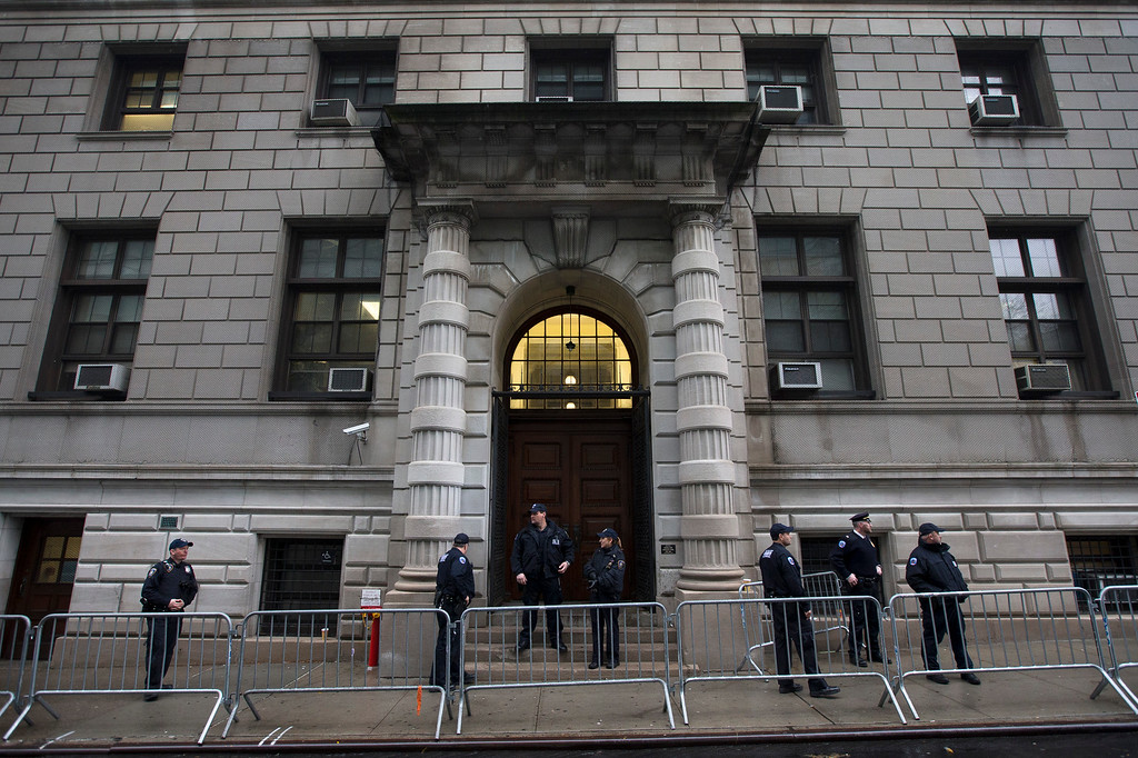 . Security personnel stand outside Richmond County Supreme Court after a grand jury\'s decision not to indict a New York police officer involved in the death of Eric Garner, Wednesday, Dec. 3, 2014, in the Staten Island borough of New York. A video shot by an onlooker and widely viewed on the Internet showed the 43-year-old Garner telling a group of police officers to leave him alone as they tried to arrest him. The city medical examiner ruled Garner\'s death a homicide and found that a chokehold contributed to it.  (AP Photo/John Minchillo)