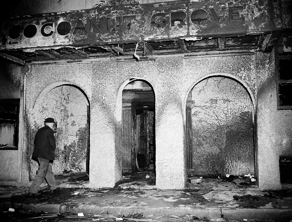 . A man heads toward the three archways at the front entrance of the burned Cocoanut Grove nightclub in the Back Bay section of Boston, Nov. 29, 1942, where a fire took the lives of 492 patrons last night.  (AP Photo)
