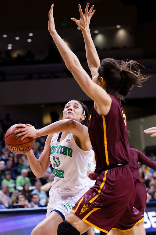 . Notre Dame forward Natalie Achonwa (11) drives to the basket on Arizona State center Joy Burke (3) during the second half in a second-round game in the NCAA women\'s college basketball tournament in Toledo, Ohio, Monday, March 24, 2014. (AP Photo/Rick Osentoski)