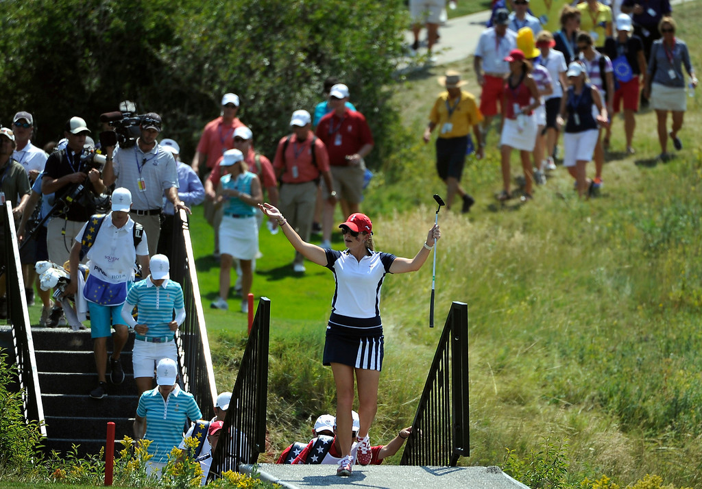 . PARKER, CO - Aug.17: Team USA\'s Paula Creamer encourages the crowd to cheer as she walks up the 17th fairway. The 2013 Solheim Cup takes place at the Colorado Golf Club with the USA taking on Europe in the Saturday morning Foursomes Match. (Photo By Kathryn Scott Osler/The Denver Post)