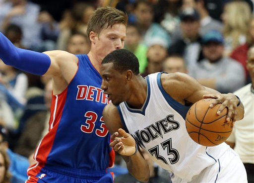 . Minnesota Timberwolves\'  Thaddeus Young, right, drives around Detroit Pistons\' Jonas Jerebko of Sweden  in the second half of an NBA basketball game, Thursday, Oct. 30, 2014, in Minneapolis. The Timberwolves won 97-91. (AP Photo/Jim Mone)