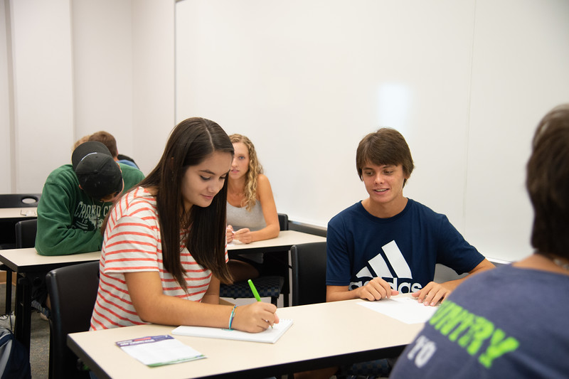 Students partner up and get to know each other on the first day.