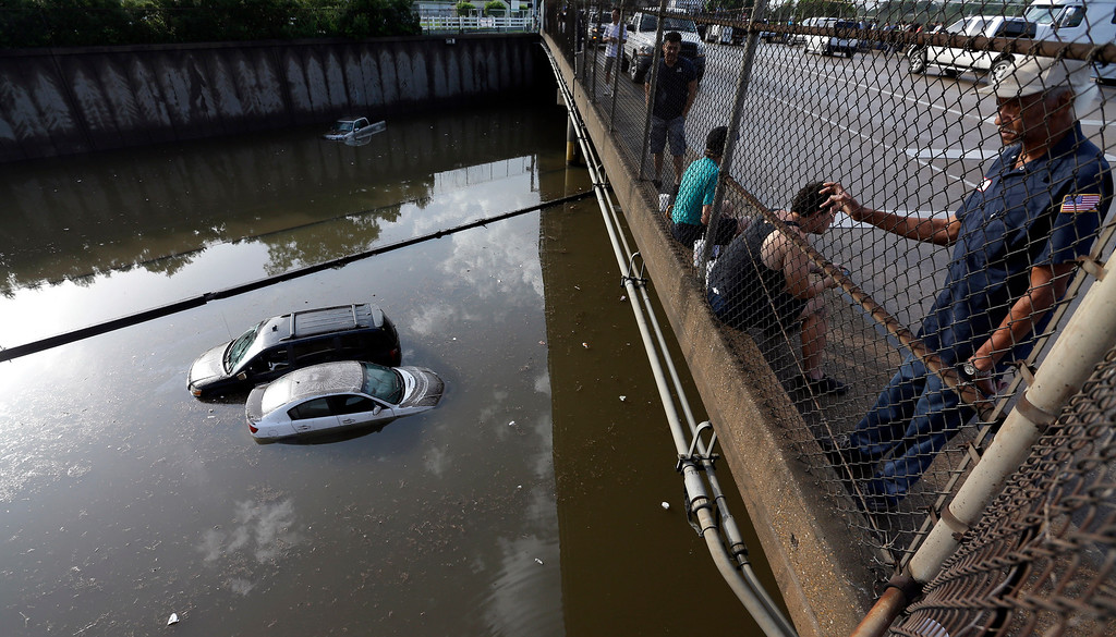 . In this May 29, 2015 file photo, cars sit in floodwaters along Interstate 45 after heavy overnight rain flooded parts of the highway in Houston. Even for a world getting used to wild weather, May seems stuck on strange. Torrential downpours in Texas, whiplashing the region from drought to flooding. A heatwave that has already killed more than 1800 in India and is the fifth deadliest since 1900. Record 91 degree temperature in of all places Alaska. A pair of top-of-the-scale typhoons in the Northwest Pacific.  And a drought in the U.S. East is starting to take root just as the one ends in Texas. (AP Photo/David J. Phillip, File)