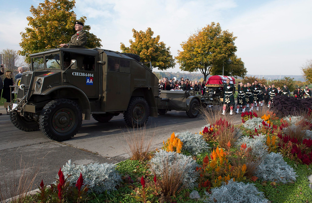 . The coffin of Cpl. Nathan Cirillo is towed on a gun carriage during his funeral procession in Hamilton, Ontario,  on Tuesday, Oct. 28, 2014. (AP Photo/The Canadian Press, Frank Gunn)