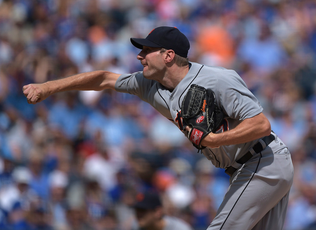. Detroit Tigers starting pitcher Max Scherzer throws against the Kansas City Royals during the first inning of a baseball game Saturday, Sept. 20, 2014, in Kansas City, Mo. (AP Photo/Reed Hoffmann)