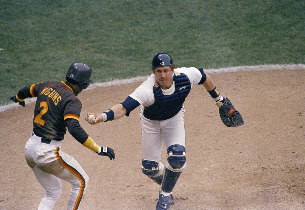 . San Diego Padres Alan Wiggins tries to avoid the tag by Detroit Tigers catcher Lance Parrish as Wiggins overran home-plate and then tried to go back and touch it but was tagged out by Parrish in 1984. (AP Photo)