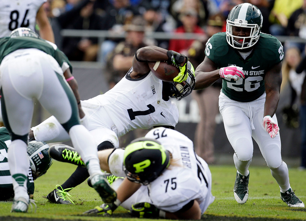 . Purdue running back Akeem Hunt (1) scores on a three-yard carry in front of Michigan State safety RJ Williamson (26) during the second quarter of an NCAA college football game in West Lafayette, Ind., Saturday, Oct. 11, 2014. (AP Photo/AJ Mast)