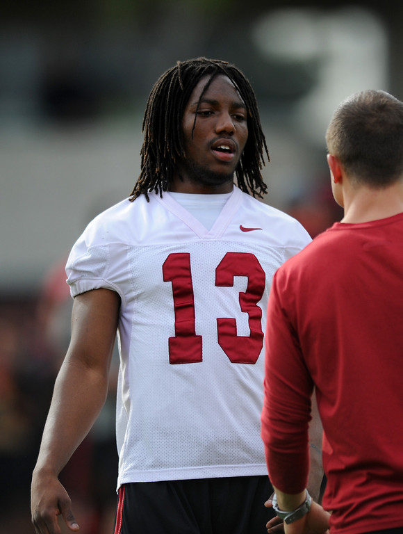 . USC DB Kevon Seymour talks with an assistant at spring practice, Tuesday, March 11, 2014, at USC. (Photo by Michael Owen Baker/L.A. Daily News)